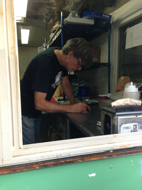 Ed Begley Jr -- I mean Phil Lesh -- inside his Homegrown Smoker food cart.